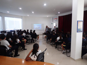Conservation interns Sierra and Barbara delivering a presentation to over 100 students and teachers at Colegio St. John's.